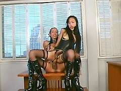 Two latex ladyboys fuck