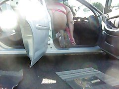 cleaning the car in a thong 2