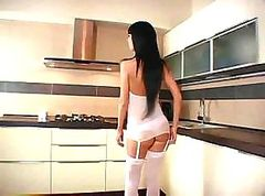 Nice looking teen is getting cooked by a black dick in the kitchen